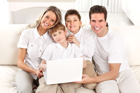 Happy family. Father, mother and boy working with laptop. Stock Photo - 12137512
