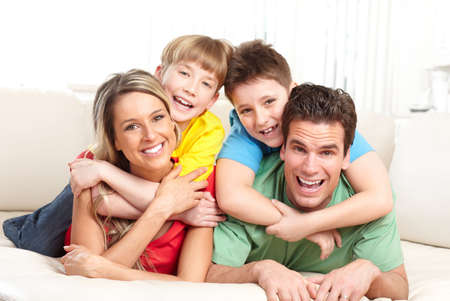 Happy family. Father, mother and children at home  photo