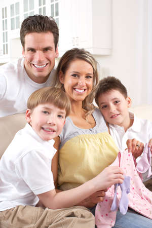 Smiling beautiful pregnant mother and family  at home  photo