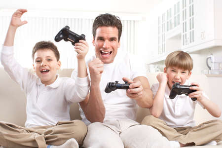 Happy family. Father, mother and children playing a video game   Stok Fotoğraf