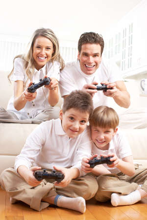Happy family. Father, mother and children playing a video game   Stock Photo
