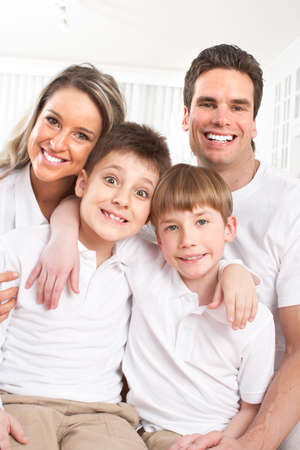 Happy family. Father, mother and children at home Stock Photo - 12133726