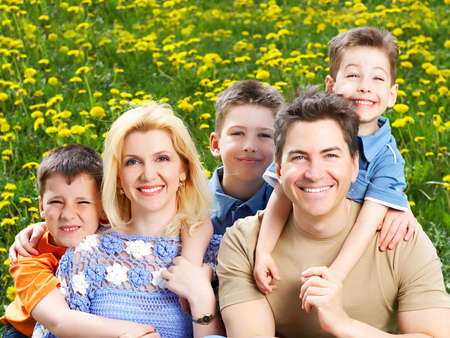 Happy family. Father, mother and sons in the park photo