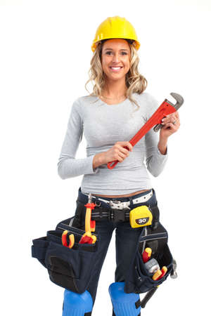 builders: Young builder woman with wrench. Isolated over white background  Stock Photo