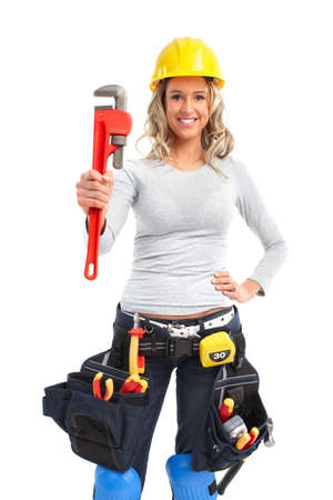 Young builder woman with wrench. Isolated over white background