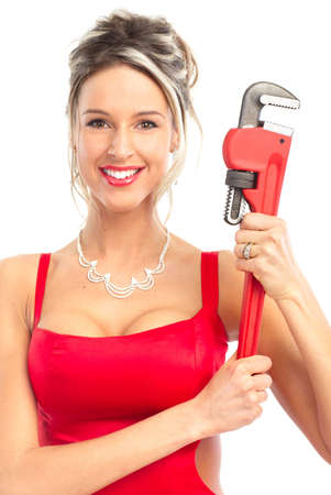Beautiful young sexy woman with adjustable wrench . Over white background  photo