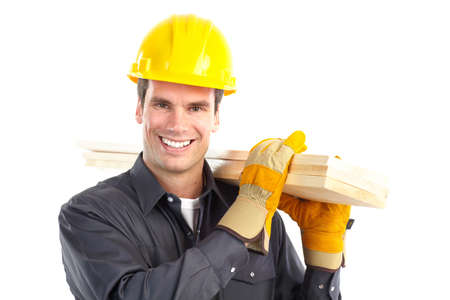Young handsome builder. Isolated over white background  photo