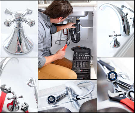 Young plumber fixing a sink Stock Photo - 6637716