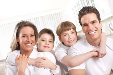 Happy family. Father, mother and children at home Stock Photo - 12137540