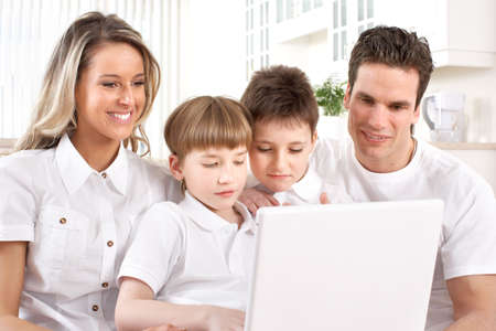 internet love: Happy family. Father, mother and boy working with laptop.