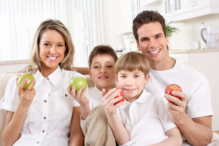Happy family. Father, mother and children at home Stock Photo - 12137520