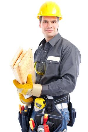 dělník: Young handsome builder. Isolated over white background  Reklamní fotografie