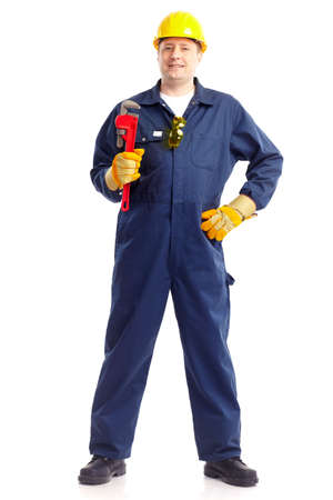adjustable: Young handsome plumber worker with adjustable wrench. Isolated over white background