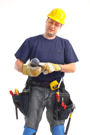 Handsome builder with tools. Isolated over white background  photo