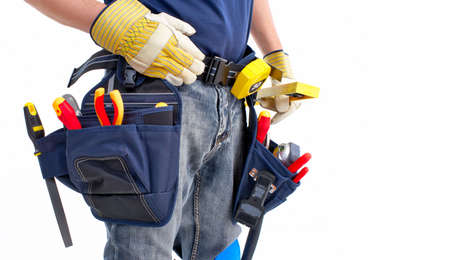 working belt: builder with belt and tools. Isolated over white background