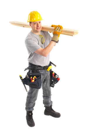 Handsome builder with wood planks. Isolated over white background Stock Photo - 6637652