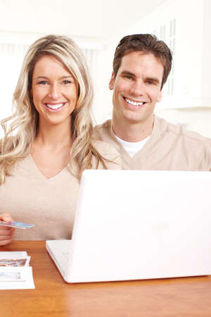 Young happy couple with laptop at home  photo