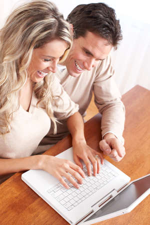sexy guy: Young happy couple in love with laptop at home  Stock Photo