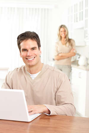 Young happy couple in love with laptop at home  photo