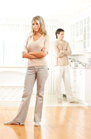 woman profile: Angry couple at home. Divorce  Stock Photo