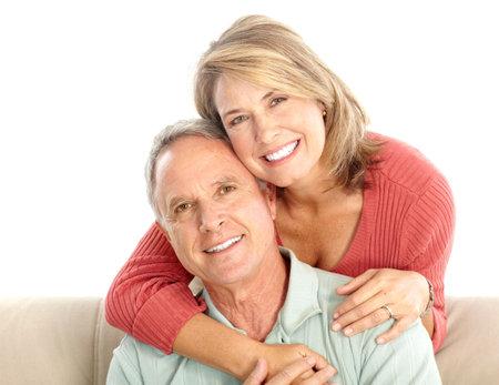 Happy elderly seniors couple. Isolated over white background  photo