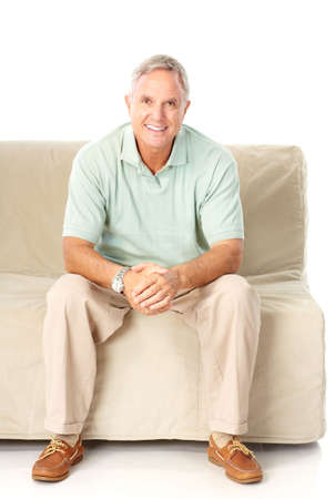 white sofa: Smiling happy elderly man. Isolated over white background  Stock Photo