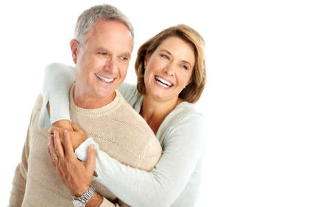 retired couple: Happy seniors couple in love. Isolated over white background  Stock Photo
