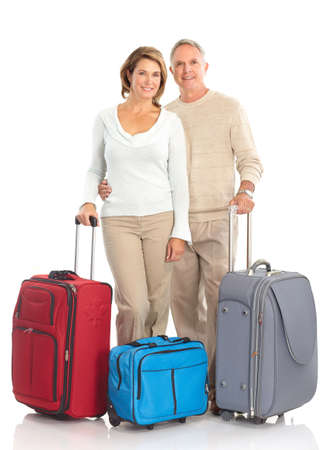 city trip: Senior couple with bags. Isolated over white background