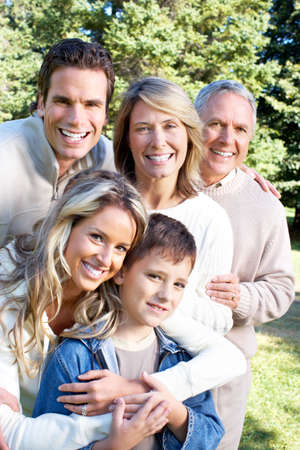 Happy family in park. Grandfather, grandmother, father, mother and son Stock Photo - 6744308