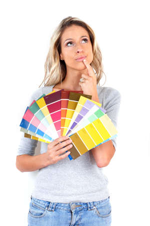 Young smiling woman choosing color for the  interior wall of home.   photo