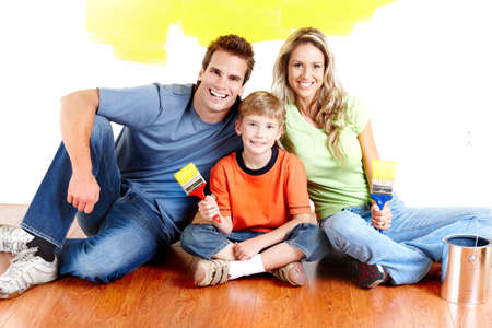 wall decor: Renovation. Young family painting interior wall of home.   Stock Photo