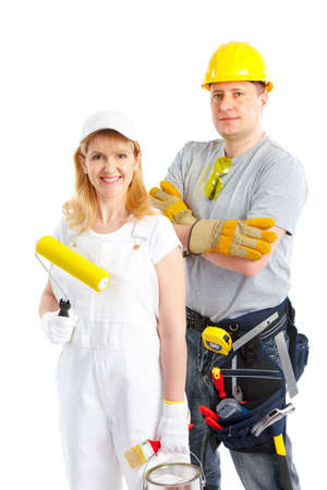 Smiling builder people. Isolated over white background Stock Photo - 6757888