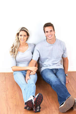 Young love smiling couple  in the new apartment  photo