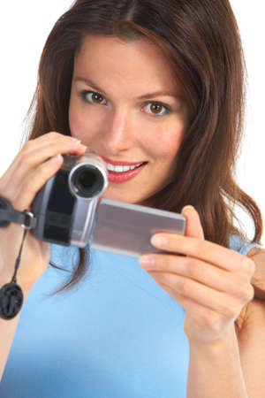 Young woman with video camera. Isolated over white background  photo
