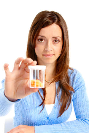 Sick young woman with pills. Isolated over white background Stock Photo - 6783502