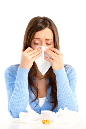 grippe: Young woman having flu or allergy. Isolated over white background