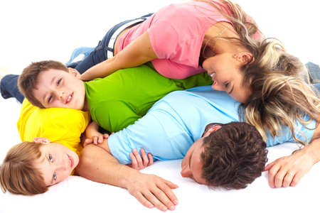 Happy family. Father, mother and children on the bed Stock Photo - 6817462