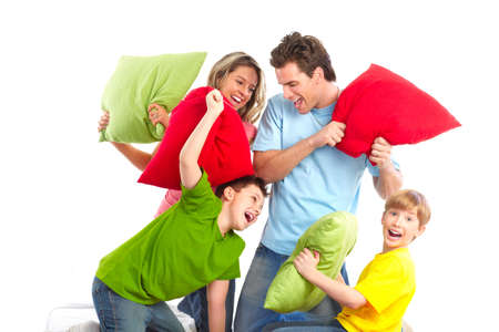 pillow fight: Happy family. Father, mother and children. Over white background