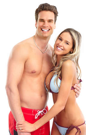 Happy smiling couple in swimming suits. Isolated over white background  photo