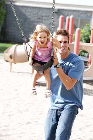 Happy family. Father and daughter in the park Stock Photo - 6817473