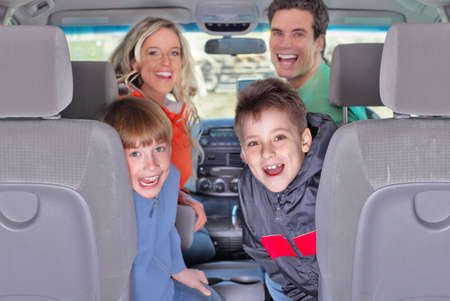 Smiling happy family in the car photo