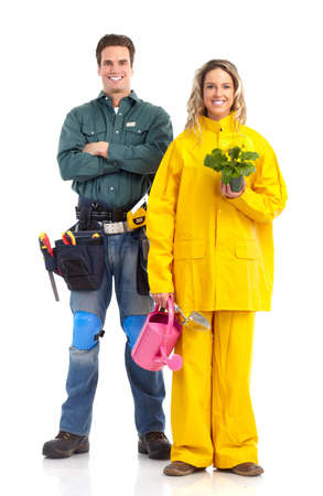 Workers. Young florist woman and a builder. Isolated over white background  photo