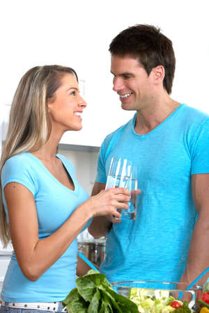Young beautiful smiling couple at home