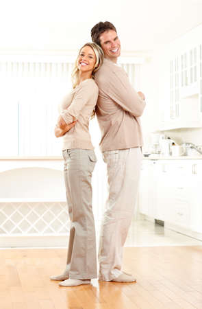 Young smiling couple at modern home Stock Photo - 6924879