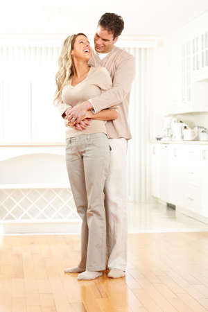 indoors: Young smiling couple at modern home Stock Photo