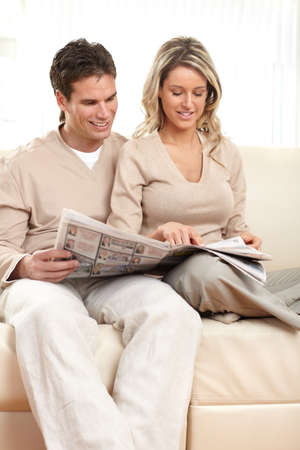 Young love couple reading a magazine  at home Stock Photo - 6924973
