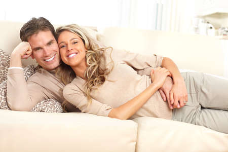 couple on couch: Young happy couple at home
