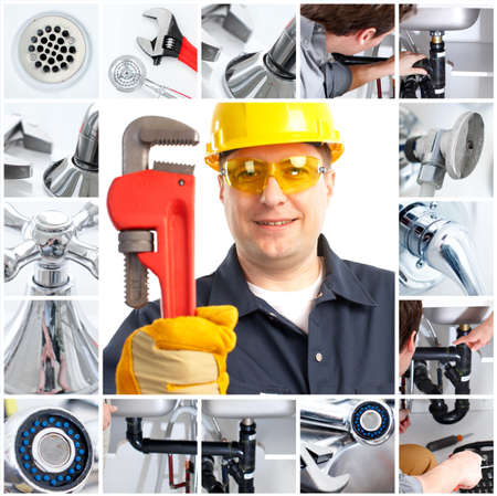 Smiling handsome plumber with an adjustable wrench Stock Photo - 6925406