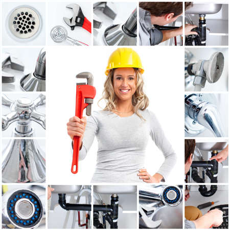 Smiling plumber woman with an adjustable wrench Stock Photo - 6925245