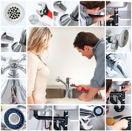 Young plumber fixing a sink Stock Photo - 6925326